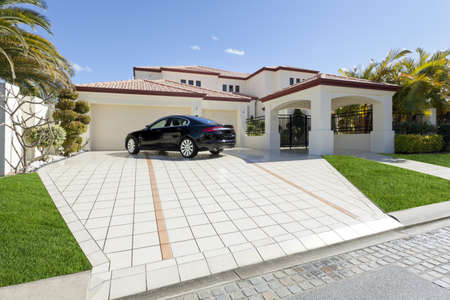 Luxury mansion with luxury car in driveway Stock Photo - 13909654