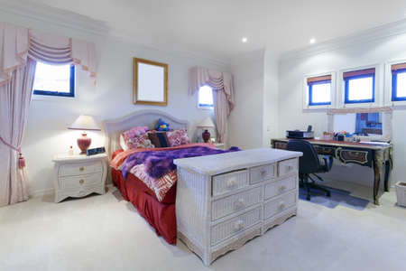 Stylish bedroom with drawers and classic desk photo