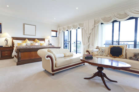 Spacious master bedroom in luxury house overlooking the water Stock Photo - 13909510