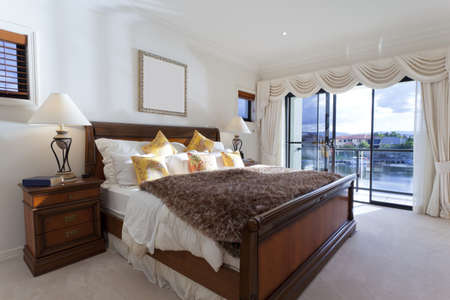 upscale: Spacious master bedroom in luxury house overlooking the water