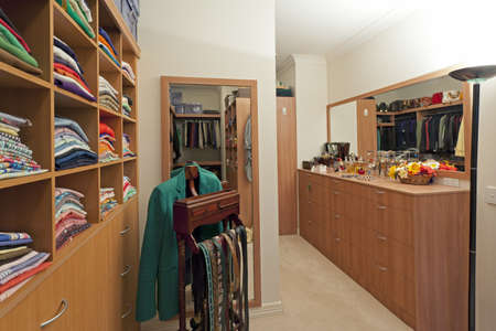 walk in closet: Luxury walk in wardrobe with clothes and jewellery