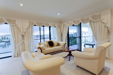 Stylish living room with view of waterfront houses Stock Photo - 13909647