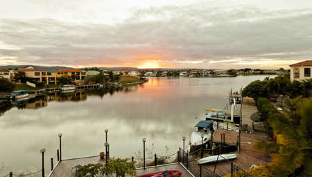 Sunset over luxury waterfront houses Stock Photo - 13863891