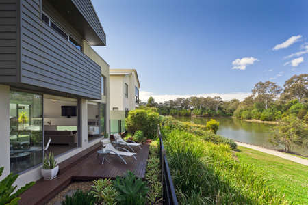 outside outdoor outdoors exterior: Modern Australian house overlooking the river Stock Photo