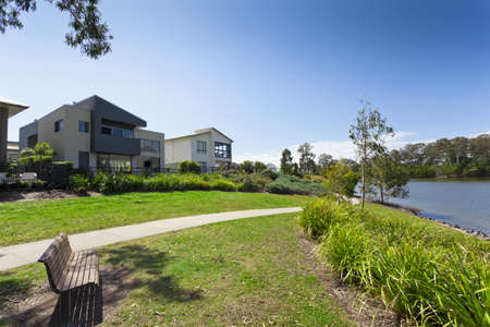 architectural exterior: Modern two storey Australian house front overlooking a park and river Stock Photo