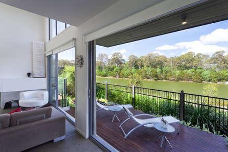 Modern Australian living room overlooking the river photo
