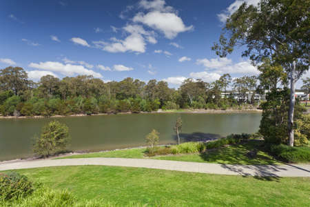 landscape riverside: River and park view in luxury Australian suburb Stock Photo
