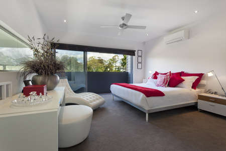luxury hotel room: Stylish master bedroom in luxury Australian mansion