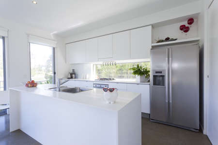 stainless steel kitchen: Modern kitchen with stainless steel appliances in Australian mansion