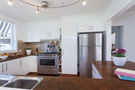 Modern kitchen with stainless steel appliances in Australian mansion photo