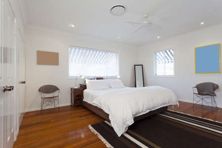 Stylish double bedroom in modern Australian home Stock Photo - 14095301