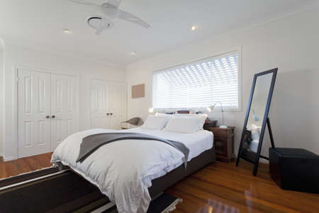 modern lamp: Stylish double bedroom in modern Australian home