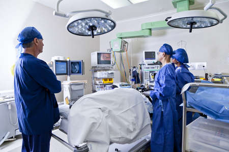 operation room: Surgery with operating table, nurses and surgeon