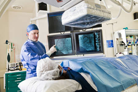 Cathlab in modern hospital with doctor, nurse and patient