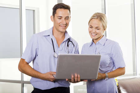 Young doctor talking with attractive nurse photo