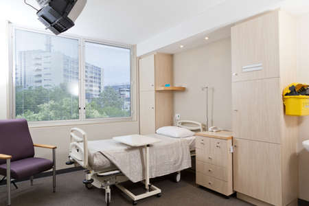 sickroom: Hospital ward with bed and medical equipment