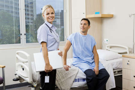 Nurse and patient in hospital ward photo
