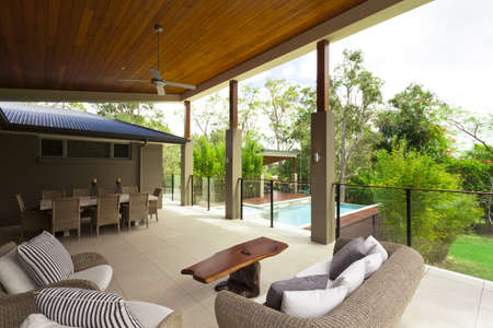 Modern backyard with entertaining area in stylish Australian home photo