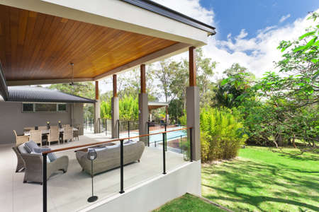 Modern backyard with entertaining area in stylish Australian home Stock Photo
