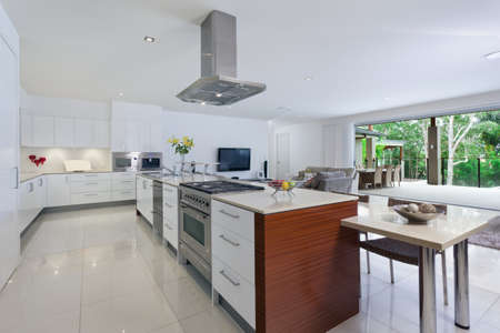 contemporary kitchen: Modern kitchen with stainless steel appliances in Australian mansion