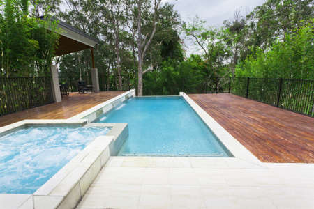 pool deck: Modern backyard with entertaining area and pool in stylish Australian home