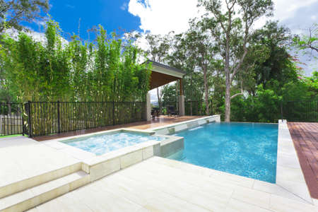 Modern backyard with entertaining area and pool in stylish Australian home Stock Photo - 15616723