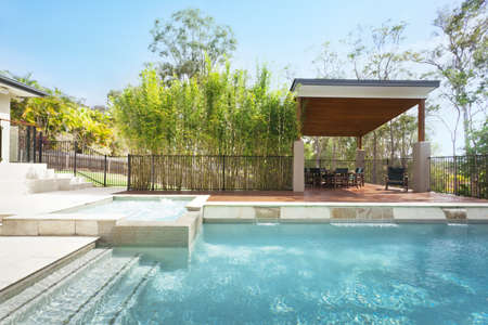 entertaining area: Modern backyard with entertaining area and pool in stylish Australian home