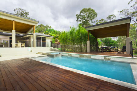 Modern backyard with entertaining area and pool in stylish Australian home photo