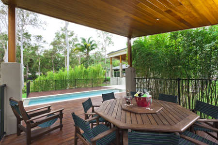 Modern backyard with entertaining area and pool in stylish Australian home Stock Photo - 15616724