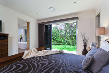 Stylish master bedroom in luxury Australian mansion photo