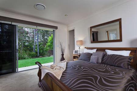 master bedroom: Stylish master bedroom in luxury Australian mansion