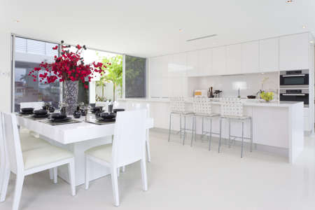 classy house: Dining area and kitchen in stylish Australian home