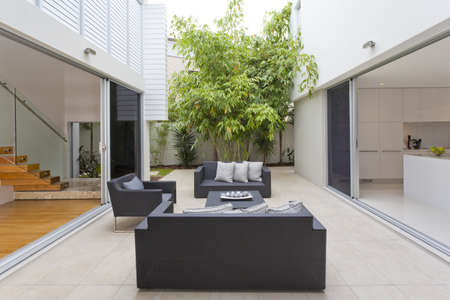 lanscape: Modern backyard with entertaining area in stylish Australian home Stock Photo