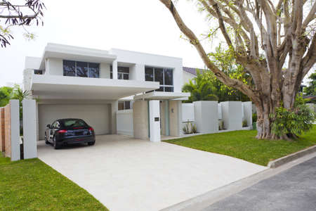 car in garage: Stylish house front with sports car
