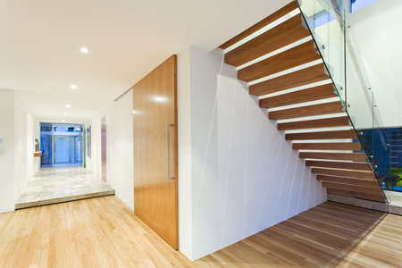 unfurnished: Stylish house interior with staircase
