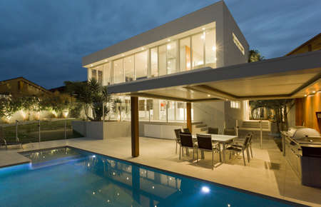 real estate house: Modern backyard with swimming pool in Australian mansion Stock Photo
