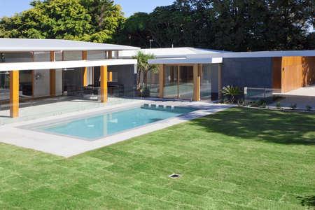 Modern backyard with swimming pool in Australian mansion 写真素材