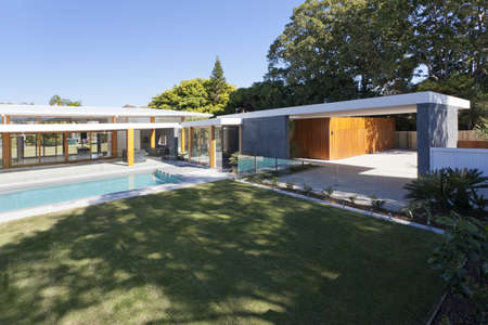 Modern backyard with swimming pool in Australian mansion photo