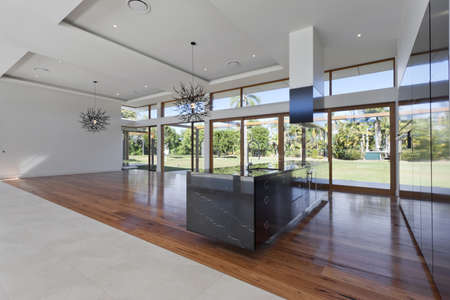 Amazing kitchen and living area in new spacious mansion Stock Photo