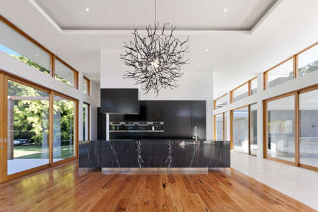 window view: Amazing kitchen and living area in new spacious mansion Stock Photo
