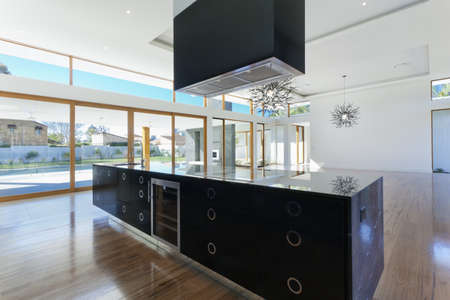 Amazing kitchen and living area in new spacious mansion photo