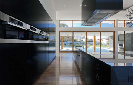 Amazing kitchen and living area in new spacious mansion Stock fotó