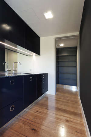 Small modern black kitchen photo