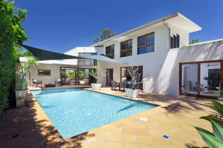 Modern backyard with swimming pool in Australian mansion Stock Photo