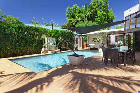Modern backyard with swimming pool and entertaining area in Australian mansion Stock fotó - 15616696