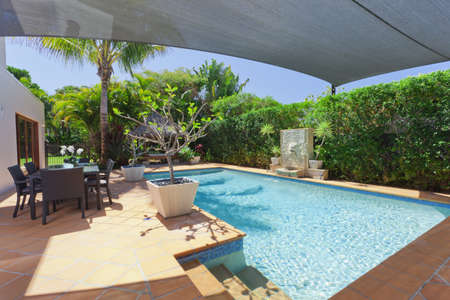 Modern backyard with swimming pool and entertaining area in Australian mansion 写真素材