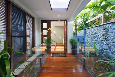 Entrance to stylish modern home photo