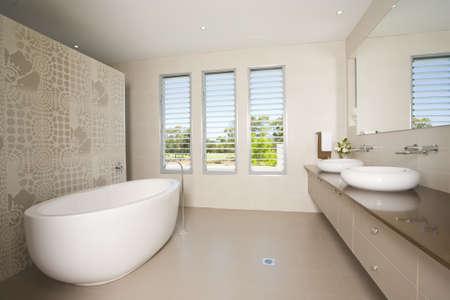 twin house: Luxury bathroom with twin sinks
