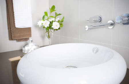 New round sink with stainless steel faucet Stock Photo - 16946460