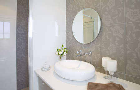 New round sink and mirror with stainless steel faucet Archivio Fotografico